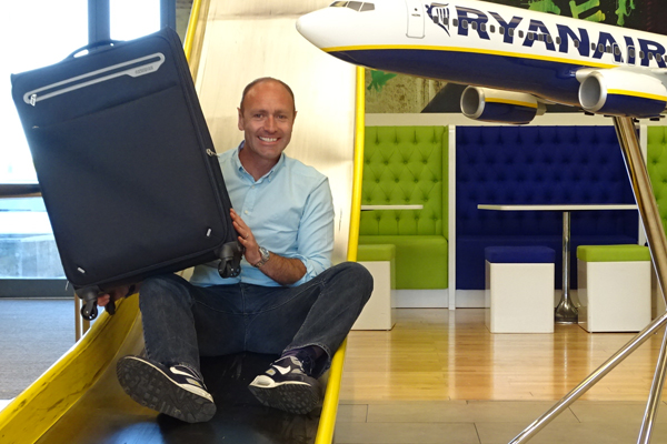 Ryanair cuts bag check-in fee by up to 50%