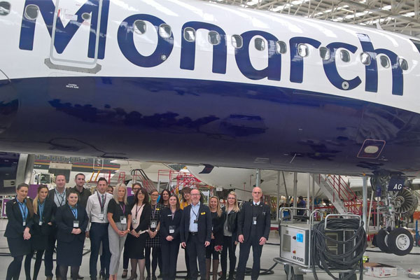 Agents go behind the scenes at Monarch's hangar facility