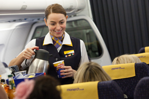 Professionals 'quitting 9 to 5 to become cabin crew'