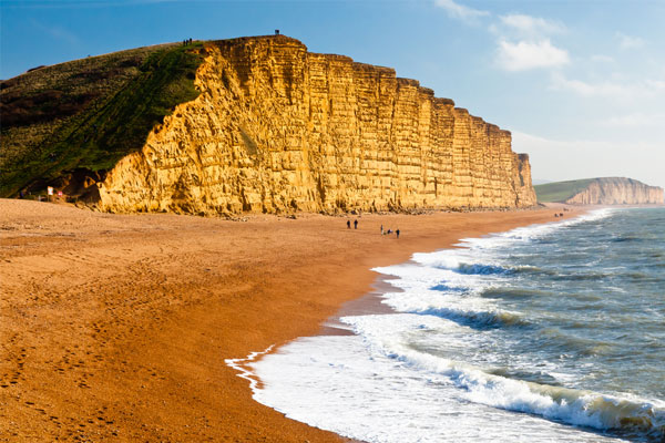 Beachgoers injured by rock fall on Dorset's Jurassic Coast
