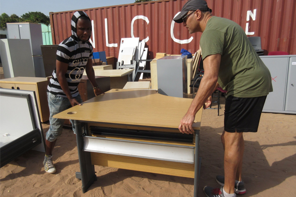 Carrick Travel donates four desks to school in The Gambia
