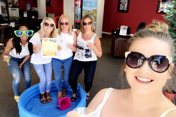 Barrhead Travel agents dress down in the sun for charity