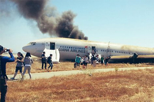 Asiana passengers file lawsuit after crash