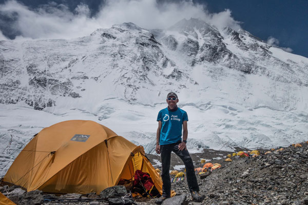 Monarch captain scales Mount Everest for Just a Drop