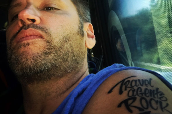 Carnival boss Perez gets 'Travel agents rock' tattooed on arm