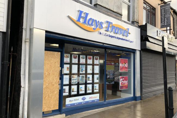 Hays Travel branch raided in 'armed robbery'
